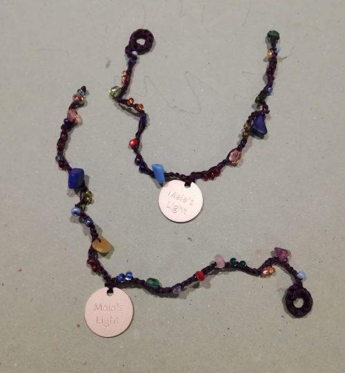 braccialetti cuoio marrone multicolori logo argento